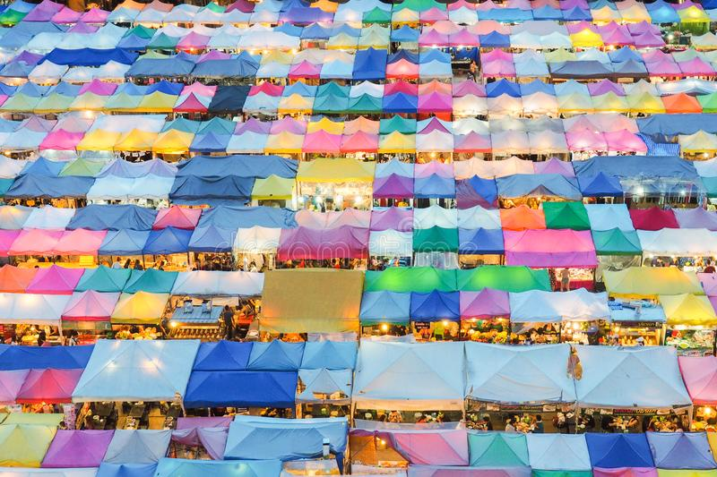 Train market secondhand market in Bangkok , Thailand.photo of night market high view from building colorful tent retail shop and. Lighting.1 oct 2016 bangkok stock image