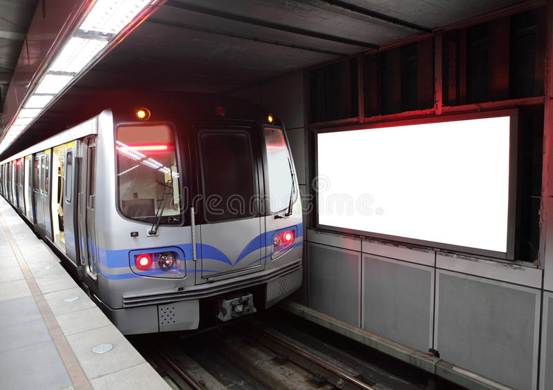 Train at metro station with billboard stock photo