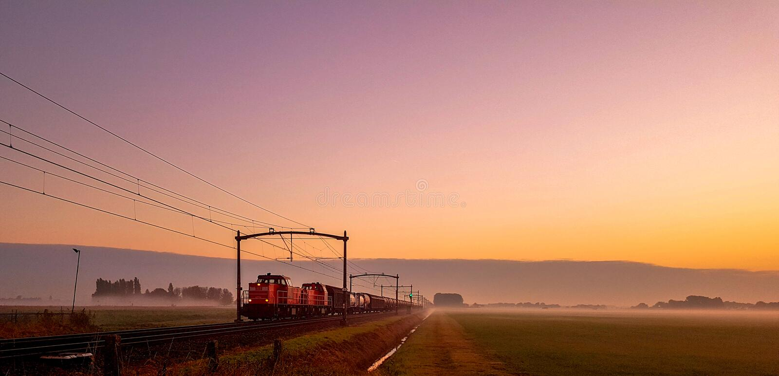 Train in the morning fog royalty free stock images