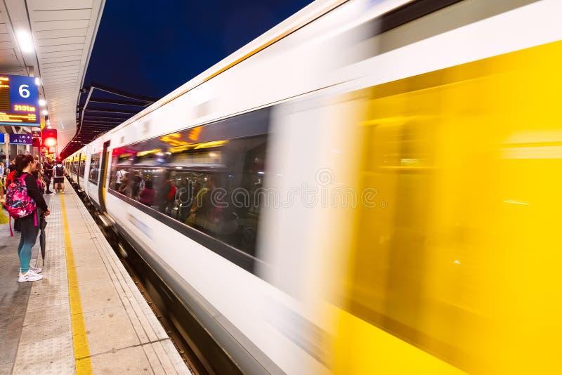 Train moving along the platform at London Bridge station in London. LONDON,UK - JULY 26,2019 : Train moving along the platform at London Bridge station royalty free stock photos