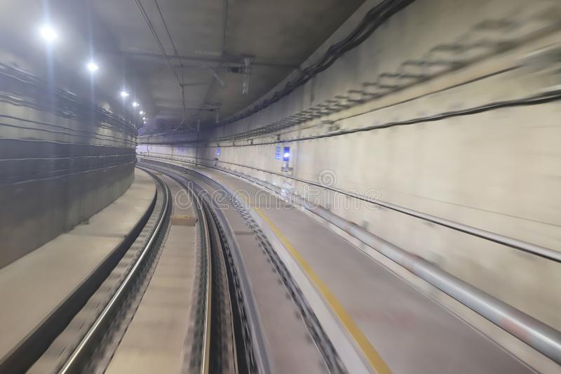 Train moving rail tunnel with moderate motion blur. Train moving in city rail tunnel with moderate motion blur stock photos