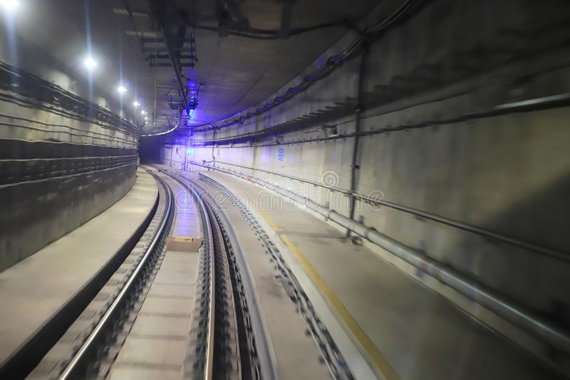 Train moving rail tunnel with moderate motion blur. Train moving in city rail tunnel with moderate motion blur royalty free stock image