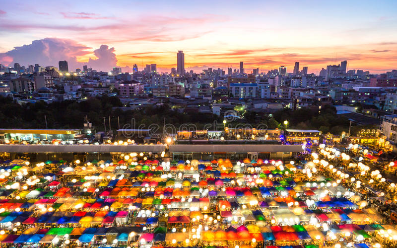 Train Night Market Ratchada is popular market shopping for thai teen and twilight time in Ratchada for bangkok pro stock photo