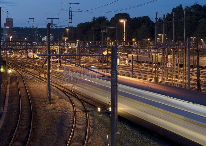 Train at night passing by stock photo