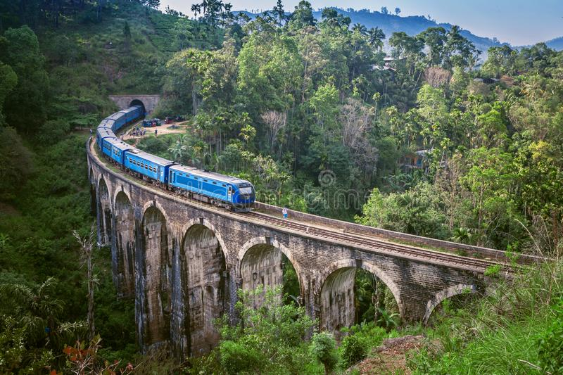 Train on Nine arch Bridge in Sri Lanka. Beautiful train track in hill country. Old bridge in Ceylon. stock photo
