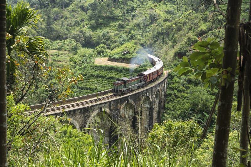 Train on the nine arche bridge, Ella, Sri Lanka. Stream train on a stone bridge in the jungle, Ella, Sri Lanka royalty free stock photography