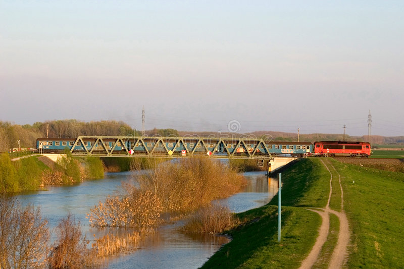 Train over the canal. The train (Budapest -> Baja) is still leaving the bridge over the flooding Canal Sio (this canal connects the lake Balaton and the river royalty free stock images