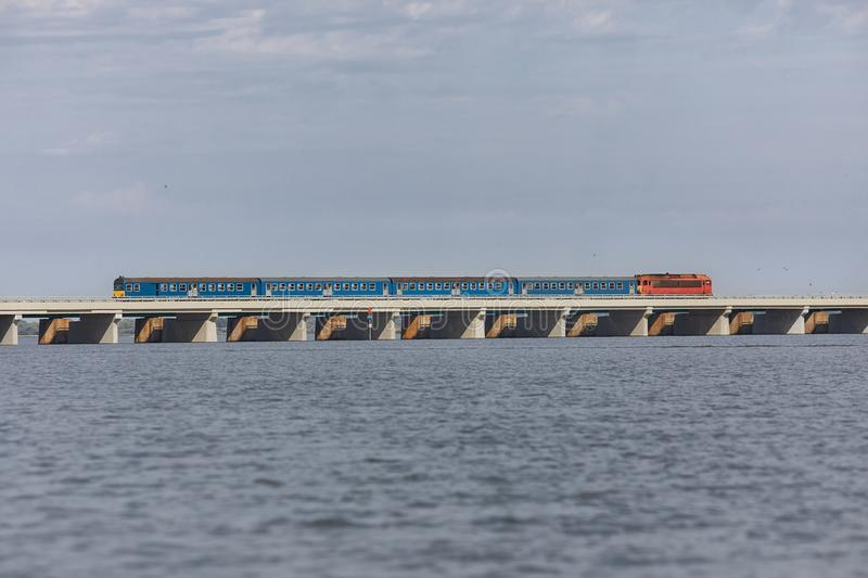 Train over a lake royalty free stock image