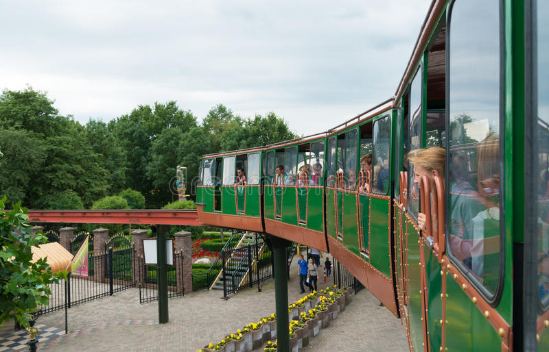 Train in park. Train with tourist in Slagharen amusement park in Netherlands. In 2011 it attracted 1.45 million visitors and it employs 1000 people stock photography