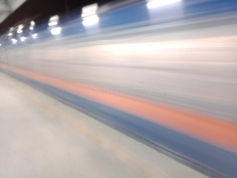 Uncatchable. A train passing by the City of Muntinlupa, Philippines royalty free stock photos
