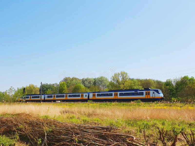 Train passing in a open field stock images