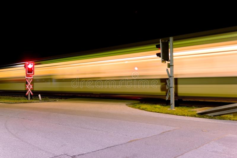 Railroad crossing a night stock photography