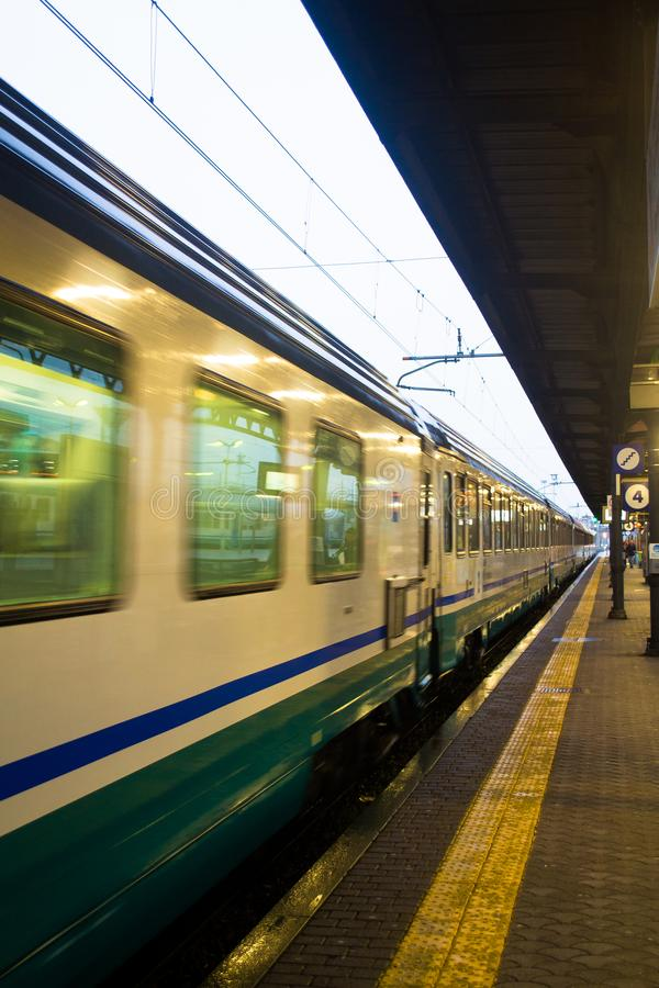 Train passing through a train station in Alessandria, Italy.  royalty free stock photography