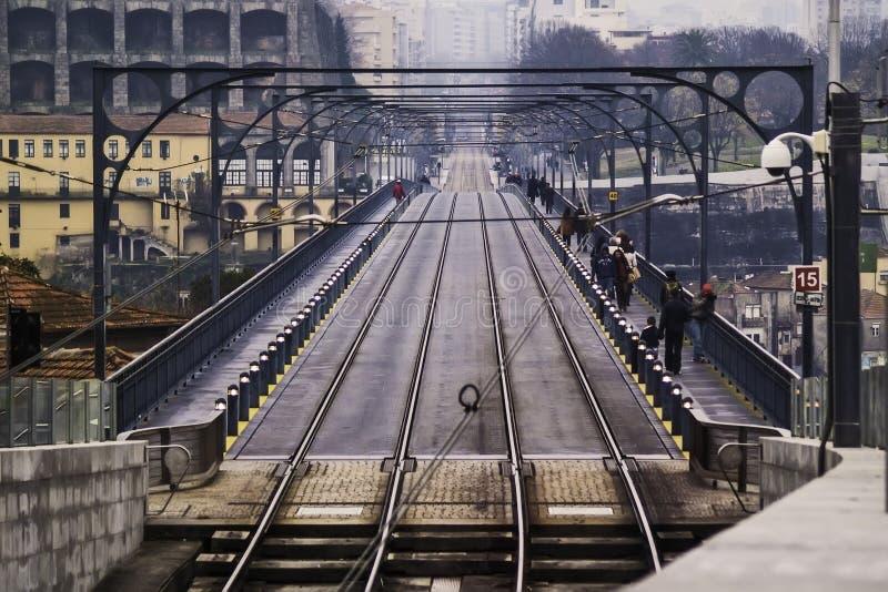 Train and pedestrian bridge royalty free stock image
