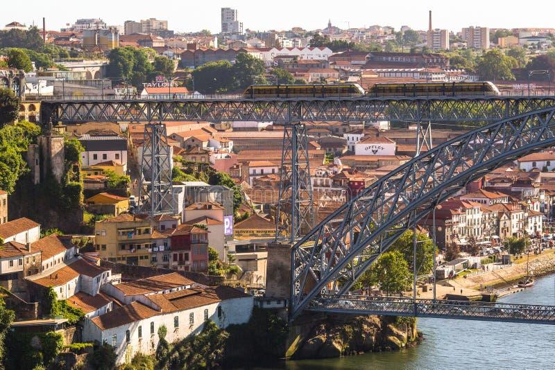 Train of Porto Metro on Dom Luis iron Bridge in Old Town royalty free stock photos