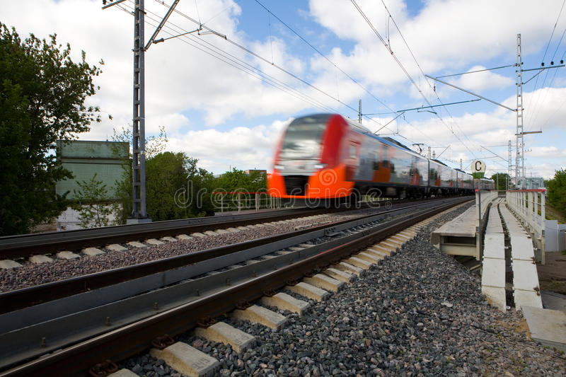 The train quickly travels along the Moscow Central Ring. royalty free stock images