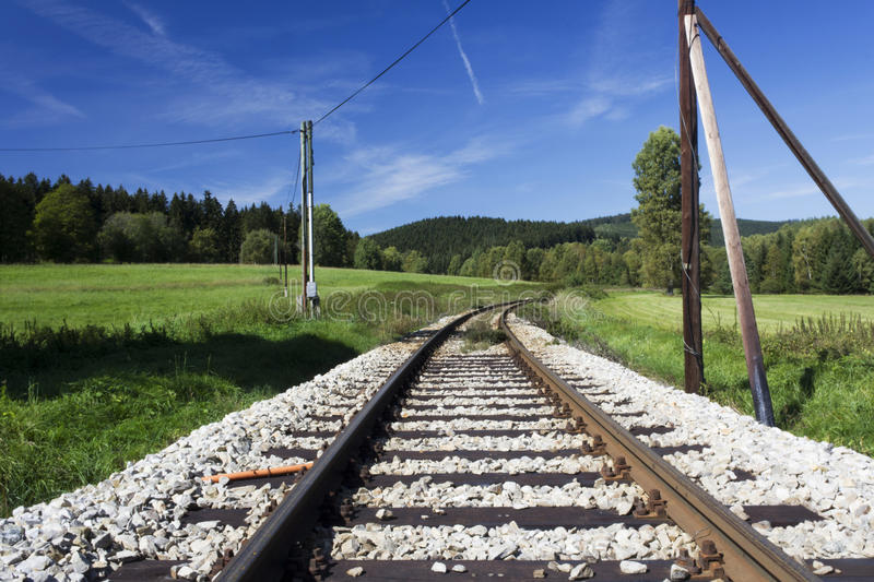 A train rail to a forest. stock photography