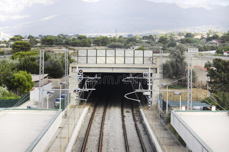 Train rail. Tunnel in the middle of the town stock photography