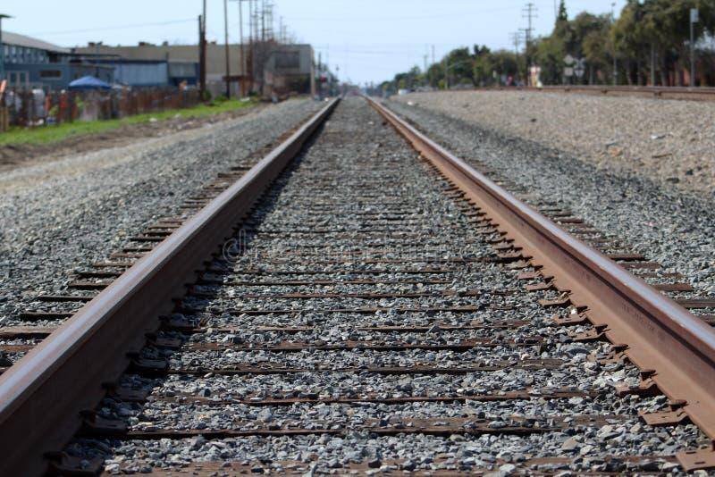 Train Railroad Tracks at a poor neighborhood. Railway Steel abandoned stock image