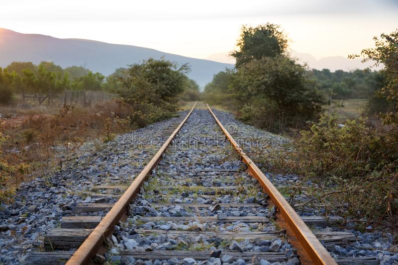 Train rails at the abandoned railroad network in Greece stock image