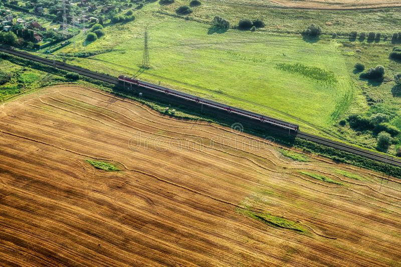 Train on rails from above. Train on rails over summer country from above royalty free stock photos