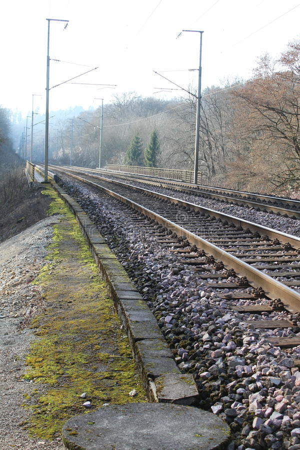 Train rails Europe. With electricity lines stock photo