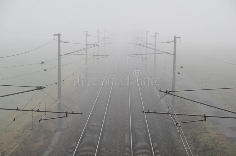 Train and rails in fog. Train and rails in dense fog stock photos