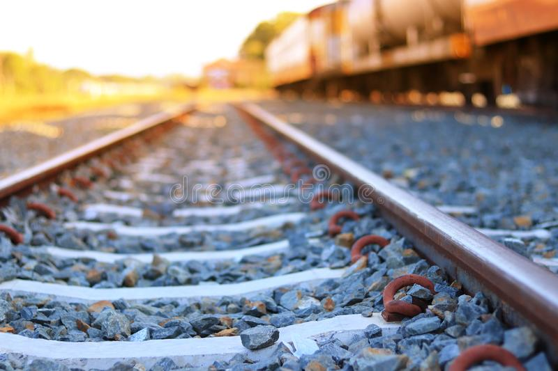The train rails in the morning when the sun shines. Transportation concept. Travel ideas stock photo