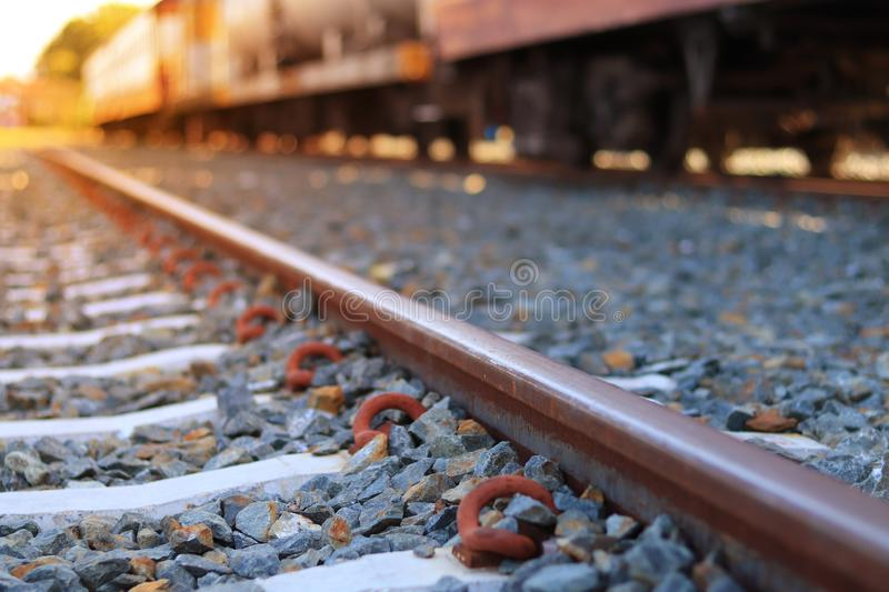 The train rails in the morning when the sun shines. Transportation concept. Travel ideas stock image