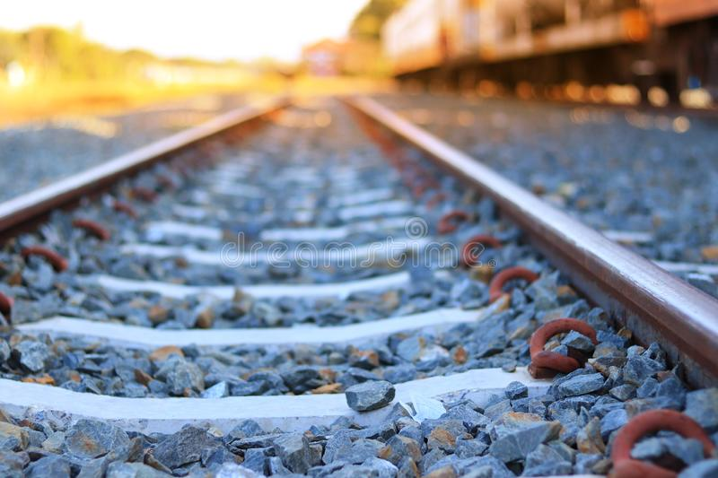 The train rails in the morning when the sun shines. Transportation concept. Travel ideas royalty free stock photography