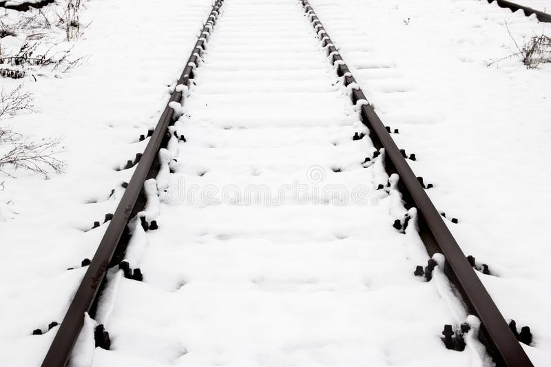 Train rails, track covered with snow during winter. stock photos