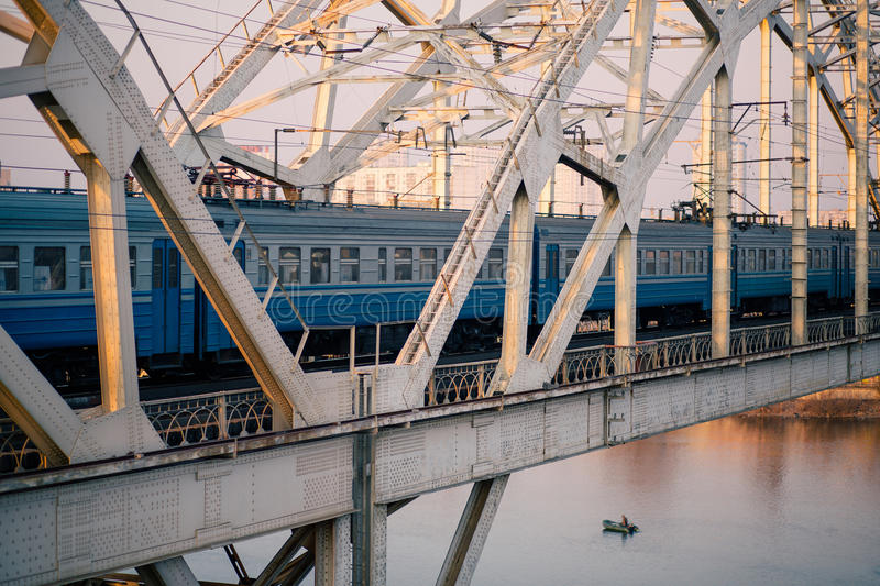 Train on the railway bridge across Dnepr river. Kiev, Ukraine royalty free stock images