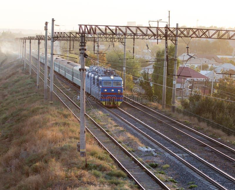 Train on the railway at sunset stock photos