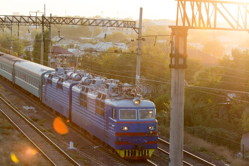 Train on the railway at sunset royalty free stock photos