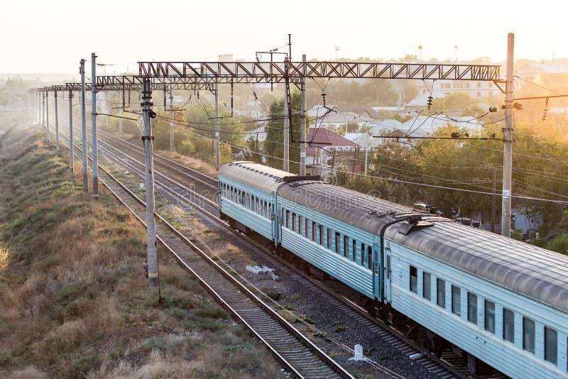 Train on the railway at sunset stock photo