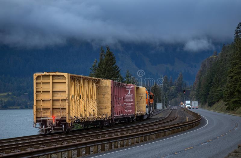 A train rolls along the Columbia River stock image