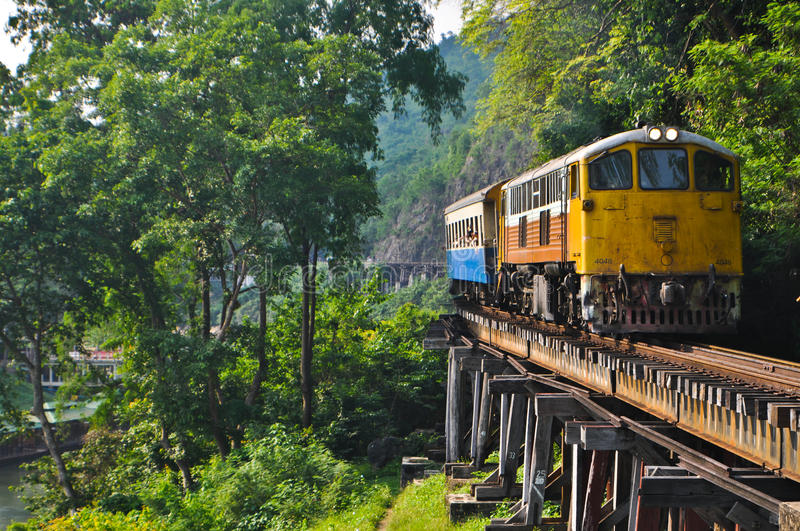 Train running on the death railway bridge. Train is running on the death railway bridge,old railway war 2 at Kanchanaburi in Thailand stock image