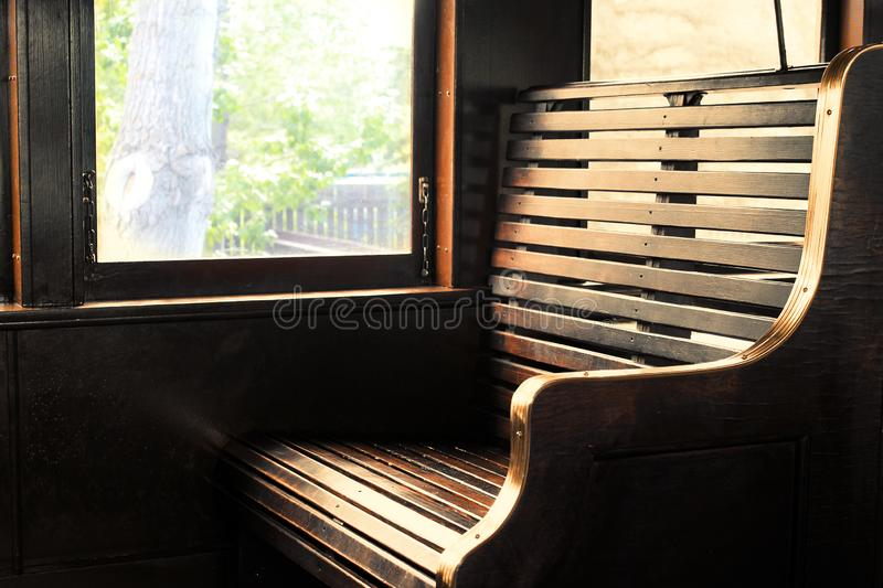 Train seat at the window. Old antique steam locomotive. Wooden seat bench at the window