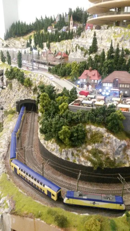 Train secret. Secret forgotten in the mountain slopes. Amazing art of railroad toys royalty free stock images