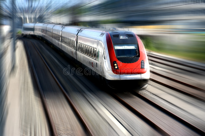 Train Series. Train speeding along its tracks. Motion blur royalty free stock photography