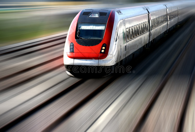 Train Series. Train speeding along its tracks with motion blur royalty free stock images