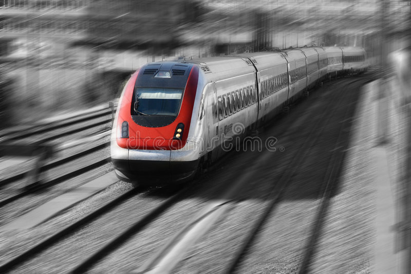 Train Series. Fast moving train. Black and white except the red front stock photography