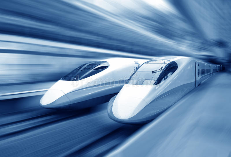 Train speeding. Two modern train speeding with motion blur royalty free stock image