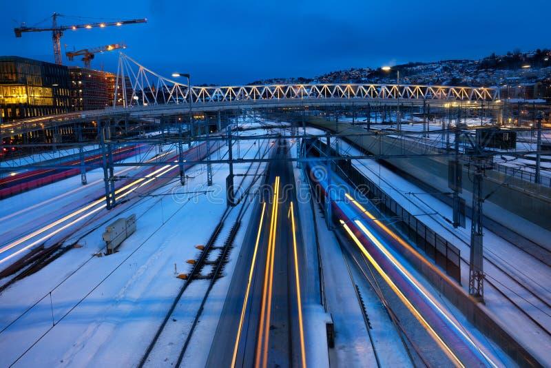 Trains speeding along tracks. Train speeding along tracks Oslo central railway station in winter stock photo