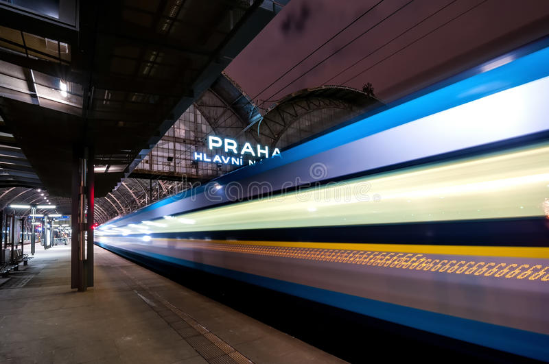 Train speeding through railway station with extended motion. royalty free stock photo