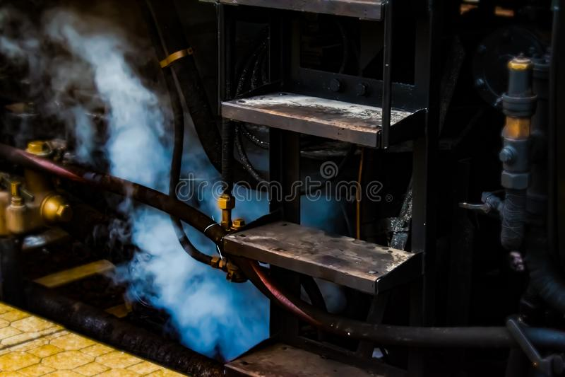 Train stairs with a steam. royalty free stock photography