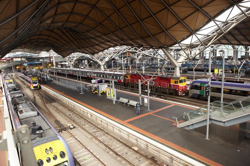 Train Station. Melbourne, Australia - April 10th, 21012 : Platforms and trains inside Southern Cross station at noon time royalty free stock image
