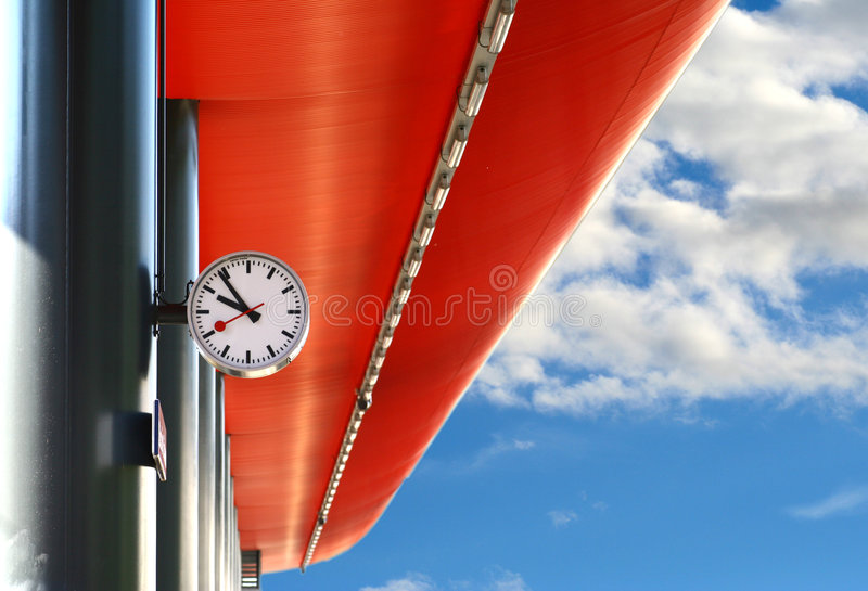 Train station. With clock and blue sky background stock images