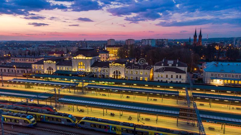 Train station and cityscape of Tarnow,Poland. Aerial drone view at twilight blue building life colorful downtown dusk europe evening above historic illuminated royalty free stock image