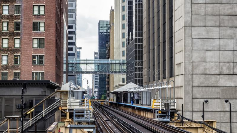 Train Station on Elevated tracks within buildings at the Loop, Glass and Steel bridge between buildings Chicago City Center royalty free stock photography